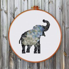 Geometric modern elephant cross stitch pattern using triangles in shades of gray and blue is a beautiful interesting handmade project for every one.  PATTERN SPECIFICATIONS: Stitches: full cross stitch, back stitch, three quarter stitch Floss: DMC stranded cotton Required Colors: 24 Designed area: 73 x 80  SUGGESTION: Fabric: 14 count Aida Strands: 2 Designed area: 5.21 x 5.71 or 13.2 x 14.5 cm  This PDF pattern contains: - Cover - Floss Palette - Color Symbol Chart - Black and White Symbol…