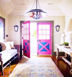 Visit a Chic Converted Barn with Cotton-Candy Punch // pink, foyer, dyed rug, lantern light, barn door