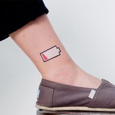 Faux tattoo:  For the days when your battery is just running low, emotionally or electronically.