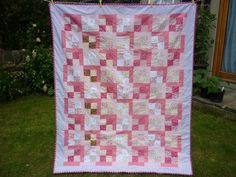 Pink small squares and rectangles patchwork quilt £45.00
