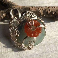A Charm Against Things Going Wrong Vintage glass, vintage button, silver wire, and a great deal of muttering.   https://nemb.ly/p/H1AmR9m5l