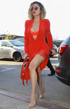 Red hot: Khloe Kardashian, 32, revealed her stunning body in Los Angeles on Friday