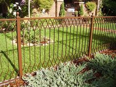 Mission style fencing.  Would lve to replace our chain link fence with this.
