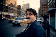 """Jeff Mermelstein - """"He highlights the absurdity of life, gives us a glimpse into our hyper real world, shows up our idiosyncrasies, our peculiarities and celebrates our differences. His pictures reveal a tenderness and joy of life in the city. This is photography as journalism. Not a documentary but rather an exploration of human behaviour, a probing of everyday banality. Each image a humorous take on urban living, a comedy of errors, a surreal farce in a beautiful and frenetic theatre of…"""