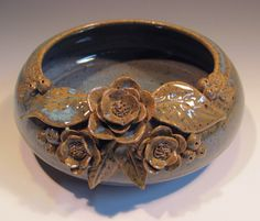 Pottery bowl, Blue Green Flowers. $41.00, via Etsy.
