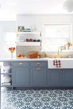 emily_henderson_ginny_macdonald_blue_cabinets | Kitchen with dominant blue color on floor and cabinet