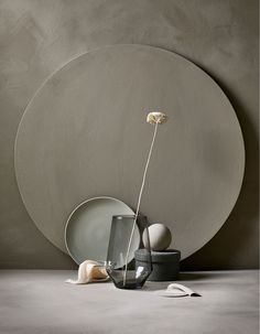 An arrangement of an IKEA PS 2017 vase in gray and a flower, a plate .:separator:An arrangement of an IKEA PS 2017 vase in gray and a flower, a plate . Wabi Sabi, Ikea Ps 2017, Carved Wood Wall Art, Art Carved, Interior Styling, Interior Design, Design Design, Prop Styling, Minimalist Living