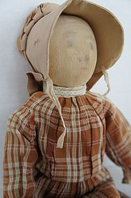 Early cloth doll with bonnet and brown calico dress