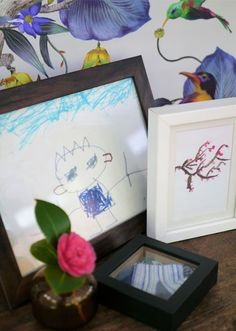 It can be hard to know how to display children's art work and mementoes without your home starting to look like a nursery school. Yes, it is your family home, meaning you want to celebrate being a family, but it needs to represent your grown-up style as well as your family's achievements. It's hard to relax in the evening after lights out with a glass of wine, if star charts are blowing off your walls.