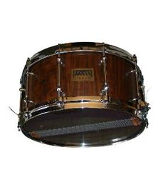 http://www.missom.com/product/125 - SNARE DRUM IPÊ - The Snare Drum MISSOM are produced by solid wood staves. The woods used are carefully selected and handled according to the highest requirements. The great advantage of the Snare Drums made by MISSOM consists in shaft vertical orientation of the wood, which improves the transmission of the beat. Available dimensions: 7 x 14'''' - 14'' x 6'' - 14'' x 4'' - 13'' x 7'' - 13'' x 6'' - 13'' x 4'' .