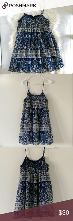 Anthropologie En Crème Boho Dress Blue and cream paisley print for a Boho summer dress. Flowy cut makes it super comfy but also very flattering. Has under lining. Chest area is gathered for a babydoll look. Has adjustable straps. Bust measures 15' across. Length of dress is 26'.  Excellent condition. Open to offers. No trades. Anthropologie Dresses