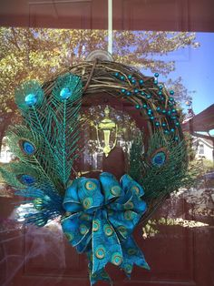 Peacock Grapevine Wreath by SouthernChickCrafts on Etsy https://www.etsy.com/listing/252473169/peacock-grapevine-wreath