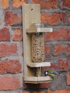 Ways to reuse your old wine bottles: turn it into a classy bird feeder