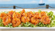 """""""Sweet Chili Shrimp"""" appetizer at Red Lobster.  I had these this week.  Battered shrimp in a sauce with the perfect amount of spiciness. . . .   Eating bites of lettuce in between keeps the heat in check.  Really enjoyed these!"""