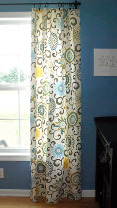 AFTER - Learn how to whip up a set of curtains in no time at all -- without sewing a single stitch
