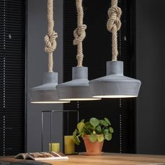 This ceiling light with twisted rope is now available at Furnwise! A very tough looking lamp, it will fit in any interior due to the use of materials! Drop Lights, Hanging Lights, Hanging Kitchen Lights, Kitchen Lighting, Chaise Noir Design, Deco Baroque, Concrete Light, Industrial Ceiling Lights, Led Röhren