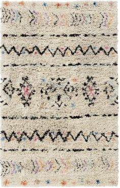 A colorful and cozy moroccan-inspired rug...the perfect addition to any space! Free shipping + currently 49% off. Click to shop! | Rugs Direct