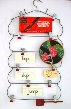 Clip display area from a retro multi-skirt hanger by 22 DIY Projects with Repurposed Hangers | diy crafts