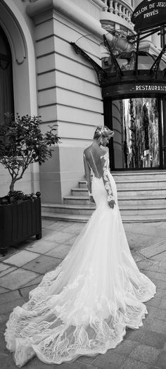 That train though! Bergenia by Alessandra Rinaudo, an elegant lace wedding dress with showstopping back.