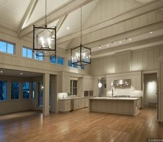 Don't love the modern finish so much, but I love the layout: huge island, bump out dining room and vaulted great room.