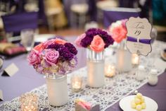 A stunning table set up with gorgeous purple and peach roses as the table centerpiece. Photographer: Holli B Photography | Wedding planner: Sharon Holm www.tulsaweddings.com | Florist: The Bridal Garden www.bridalgardenbylindi.com | Stationery: Paper 8 www.communicatecreatively.com | Rental: Party Pro Rents www.partyprorents.com