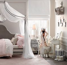 RH baby&child's Pewter Demilune Canopy Bed Crown:A wall-mounted crown equipped with built-in drapery rods (and the drapery of her choice) transforms an ordinary room into an enchanted bedchamber fit for a princess.