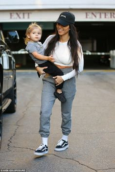 Hot momma: Kourtney Kardashian was looking happy solo as she stepped out in Calabasas, California, with Penelope on her hip