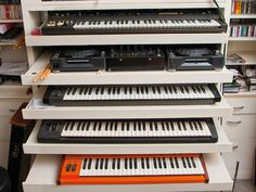 This is it! This is what we need. Pull-out keyboard shelves