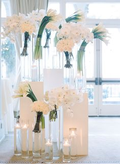 Photography: Erin Hearts Court - erinheartscourt.com Floral Design: Bloompia - www.bloompia.com/ Read More on SMP: http://www.stylemepretty.com/2014/10/31/white-on-white-santa-monica-winter-wedding/