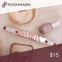 AMOR bracelet | BCBG | Rose gold AMOR letters with a heart in rose gold on a white band bracket BCBGeneration Jewelry Bracelets