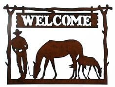 """Western Home Decor Welcome Sign Cowboy Mare and Foal 14.5"""" Wide 18 gauge Steel in rustic finish Plasma cut to produce distressed edges Cowboy and Horses Made in USA"""