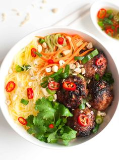 "These caramelized pork meatball ""vermicelli"" bowls are made with paleo-friendly caramel and spaghetti squash instead of noodles."