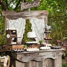 oh i love this its a wonderful way to display the cake and desserts. old dresser or this appears to be reclaimed wood. via:weddingomania  comments:walkingonsunshine:)