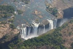 Victoria Falls bordering Zimbabwe and Zambia in Africa. This waterfall lies at the border of Zambia and Zimbabwe and it is the widest waterfall in Africa. Places To Travel, Places To See, Travel Destinations, Holiday Destinations, Wonderful Places, Beautiful Places, Amazing Places, Places Around The World, Around The Worlds