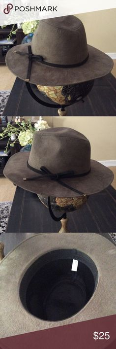Hat This hat is a greyish green color with a black tie. Worn 2 times. Accessories Hats