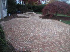 brick walled patio | patio design that leverages brick. this is a ... - Brick Patio Design