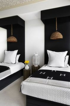 Black accent twin beds featuring black Hermes throws in small bedroom