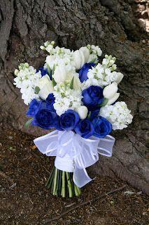 cobalt blue roses, white stock, white tulips and white roses.