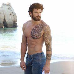 Stu on the beach in jeans