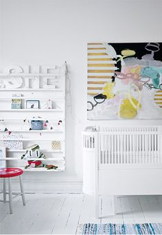 White nursery with art.