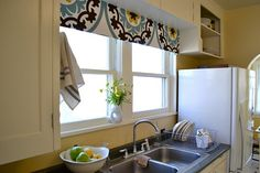 Have this table cloth to make roman shade in window