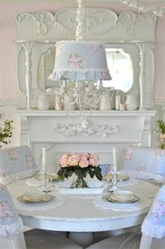 Shabby Chick Living Room in White with Pink Roses, Ornate Fireplace, Table with Chairs, Candles