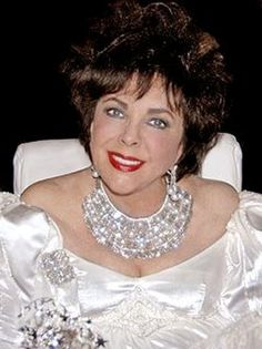 Elizabeth Taylor, beautiful photo of her, love her necklace and pin.