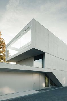 white concrete house, Lake House in Zurich by E2A Architects
