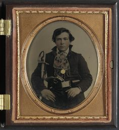 Unidentified soldier in Confederate uniform with cavalry sword and revolver. LOC.