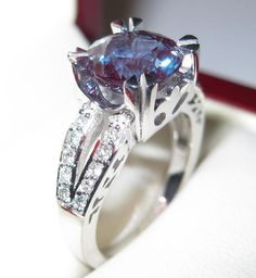 Alexandrite , This stone constantly changes color depending on what light you are standing in. Super rare and super expensive and super beautiful! I Love Jewelry, Jewelry Rings, Jewelry Accessories, Unique Jewelry, Body Jewelry, Engagement Ring Buying Guide, Engagement Rings, Alexandrite Jewelry, June Birth Stone