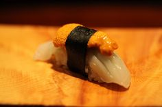 """""""Uni,"""" sea urchin on the """"Ika,"""" squid...OMG! This is totally my dream piece of sushi!!!"""