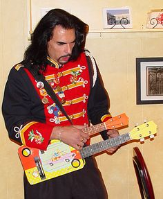 Ukulele Ray with his world's first double-neck acoustic/electric ukulele made from an over-sized Simpsons lunchbox, celebrating it's 10th anniversary.