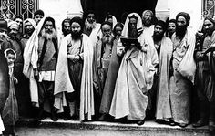 Rabbis at the entrance of El Ghriba synagogue, Tunisia, 1940's. Beit Hatfutsot