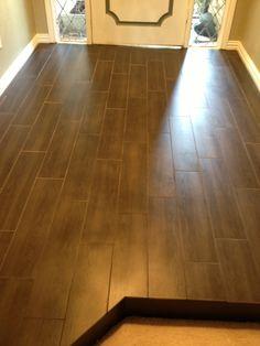 Our new tile that looks like hardwood. Eleganza Hampton Walnut tile. Love my new floors!